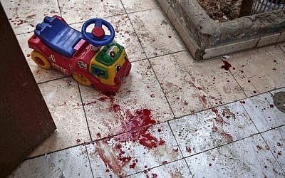 A picture shows the blood stained floor of a kindergarten following reported shelling in the rebel-held area of Harasta, on the northeastern outskirts of the capital Damascus, on November 6, 2016. (AFP PHOTO/Sameer Al-Doumy)