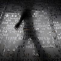 A picture taken on October 17, 2016 shows an employee walking behind a glass wall with machine coding symbols at the headquarters of Internet security giant Kaspersky in Moscow. (AFP/Kirill KUDRYAVTSEV)