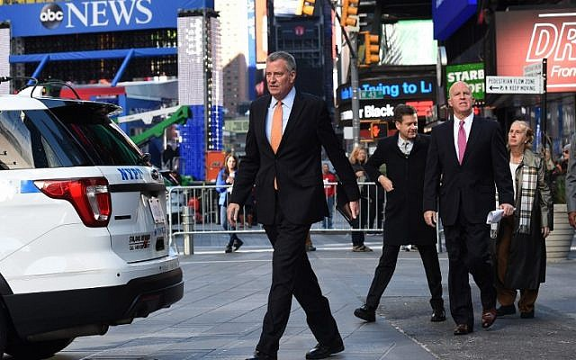 New York Mayor Bill de Blasio(L) and NYPD Police Commissioner James O'Neill (R) arrive to hold a news conference in Times Square on November 7, 2016, to discuss Election Day security preparations. (AFP PHOTO/TIMOTHY A. CLARY)