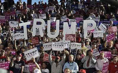 Supporters cheer at a rally for Republican presidential nominee Donald Trump at the J.S. Dorton Arena in Raleigh, North Carolina on November 7, 2016. (AFP PHOTO / MANDEL NGAN)