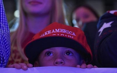 A child watches as Republican presidential nominee Donald Trump speaks during a rally at the Lackawanna College Student Union in Scranton, Pennsylvania, on November 7, 2016. (AFP PHOTO / MANDEL NGAN)