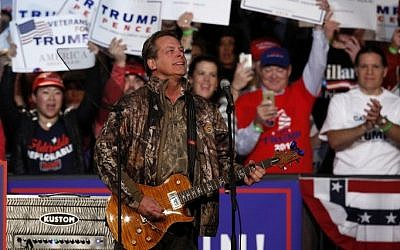 US musician Ted Nugent performs the National Anthem prior to the arrival of US Republican presidential candidate Donald Trump and running mate Mike Pence for their final campaign event of the 2016 presidential election, November 7, 2016 in Grand Rapids, Michigan. AFP PHOTO / JEFF KOWALSKY)