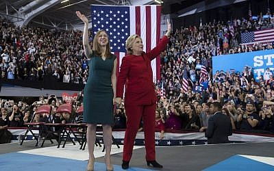 Democratic presidential nominee Hillary Clinton and her daughter Chelsea Clinton wave after a midnight rally at Reynolds Coliseum, November 8, 2016 in Morrisville, North Carolina. (Brendan Smialowski/AFP)