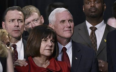 Republican vice presidential nominee Mike Pence and his wife Karen listen as his running mate Donald Trump addresses the final rally of his 2016 campaign at Devos Place in Grand Rapids, Michigan on November 7, 2016. (AFP PHOTO/MANDEL NGAN)