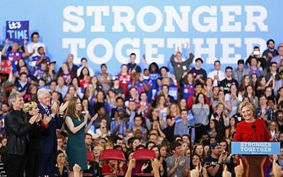 Hillary Clinton addresses the crowd of supporters inside the Reynolds Coliseum on the campus of North Carolina State University on the final campaign stop before election day, in Raleigh, North Carolina, on November 7, 2016. (AFP PHOTO / Logan Cyrus)