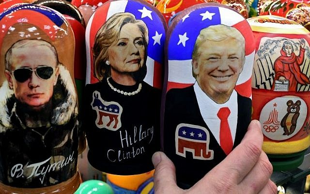 Traditional Russian wooden nesting dolls, Matryoshka dolls, depicting Russia's President Vladimir Putin, US Democratic presidential nominee Hillary Clinton and US Republican presidential nominee Donald Trump are seen on sale at a gift shop in central Moscow on November 8, 2016. (AFP PHOTO / Kirill KUDRYAVTSEV)