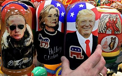 Traditional Russian wooden nesting dolls, Matryoshka dolls, depicting Russia's President Vladimir Putin, Hillary Clinton and US Republican presidential nominee Donald Trump are seen on sale at a gift shop in central Moscow on November 8, 2016. (AFP PHOTO / Kirill KUDRYAVTSEV)