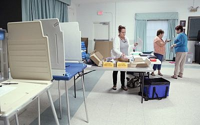 Clerks gets ready to receive voters inside a polling station in Christmas, Florida on November 8, 2016.(AFP PHOTO / Gregg Newton)