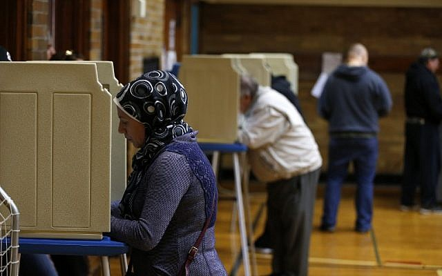 People voting at Oakman Elementary School in the US presidential election on November 8, 2016 in Dearborn, Michigan. (AFP/Jeff Kowalsky)