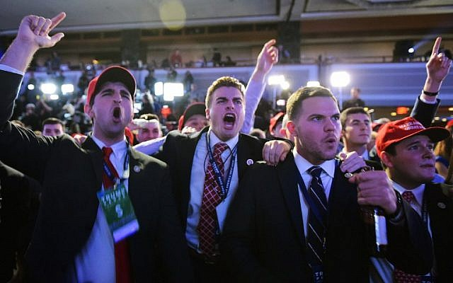Supporters of Republican presidential nominee Donald Trump reacts to early results during election night at the New York Hilton Midtown in New York on November 8, 2016. (AFP PHOTO / Mandel NGAN)