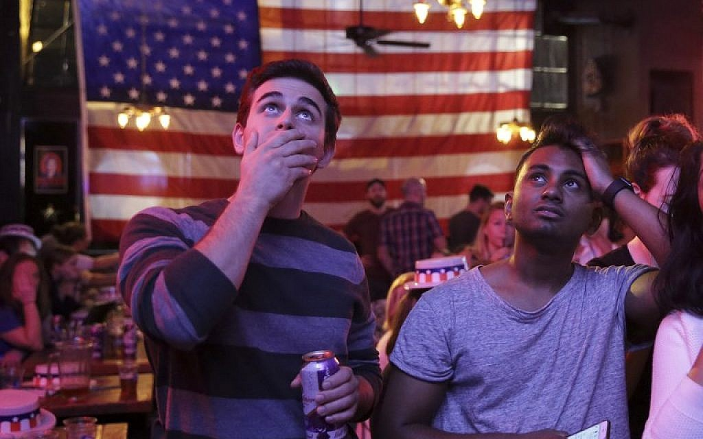 Supporters of US Democratic presidential candidate Hillary Clinton watch televised coverage of the US presidential election at Comet Tavern in the Capitol Hill neighborhood of Seattle, Washington, on November 8, 2016. (AFP/Jason Redmond)