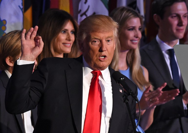 Republican president-elect Donald Trump, flanked by members of his family, speaks to supporters during election night at the New York Hilton Midtown on November 9, 2016. (AFP PHOTO/Timothy A. CLARY)