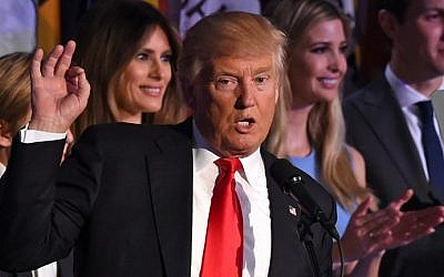 Republican presidential candidate Donald Trump flanked by members of his family speaks to supporters during election night at the New York Hilton Midtown in New York on November 9, 2016.  Trump won the US presidency. (AFP PHOTO / Timothy A. CLARY)
