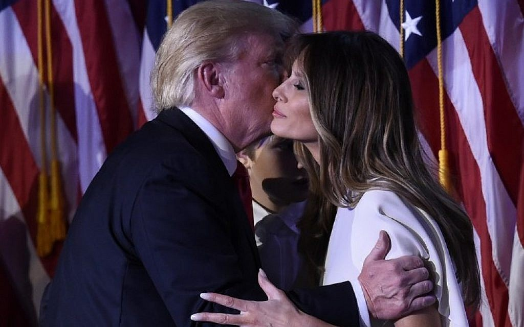 US president-elect Donald Trump greets wife Melania after speaking at the New York Hilton Midtown in New York on November 8, 2016. (AFP PHOTO/SAUL LOEB)