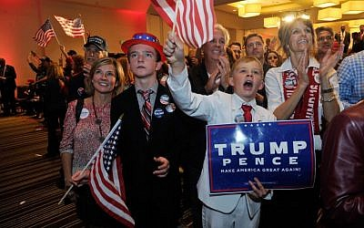 Supporters of Republican presidential nominee Donald Trump celebrate after Trump was declared as the winner of the US election while attending the Colorado GOP Election Night Party in Greenwood Village, Colorado on November 8, 2016 (AFP PHOTO / Jason Connolly)