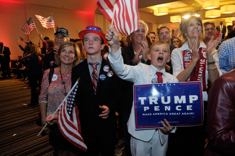 Supporters of Republican presidential nominee Donald Trump celebrate after Trump was declared as the winner of the US election while attending the Colorado GOP Election Night Party in Greenwood Village, Colorado, November 8, 2016. (AFP/Jason Connolly)