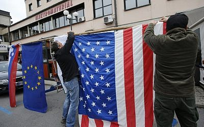 Residents of Sevnica, hometown of Melania Trump, wife of Republican presidential elect Donald Trump, hang a US flag as they celebrate the victory of Donald Trump in the race for the White House in Sevnica, Slovenia, November 9, 2016. (AFP/Jure MAKOVEC)