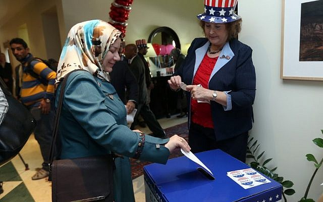 A US citizen participates in a mock election at the US ambassador's residence in Baghdad, on November 9, 2016. (AFP/ POOL / Hadi Mizban)