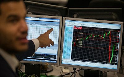 Illustrative: A trader points to a the trading terminal screen showing the S&P 500 Index. (AFP PHOTO / DANIEL LEAL-OLIVAS)