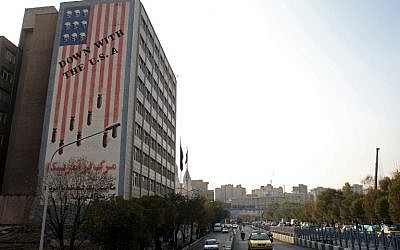 A general view shows a building bearing anti-US graffiti in the Iranian capital Tehran on November 9, 2016. (AFP/Atta Kenare)