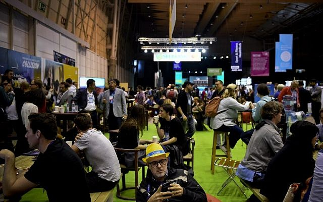 Entrepreneurs gather at the Web Summit at Parque das Nacoes, in Lisbon on November 9, 2016. Europe's largest tech event Web Summit will be held at Parque das Nacoes in Lisbon from November 7 to 10, 2016. (AFP PHOTO/PATRICIA DE MELO MOREIRA)
