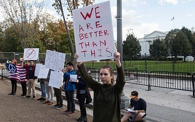 Protestors hold signs against US President-elect Donald Trump on November 9, 2016 in front of the White House in Washington, DC. (AFP PHOTO / NICHOLAS KAMM)