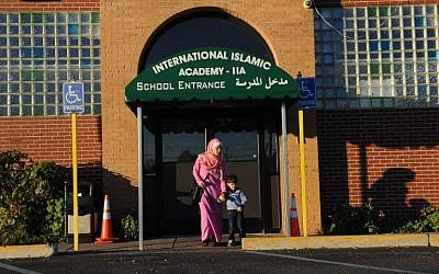 Amani Ramouni, 27, leaves the International Islamic Academy with her son Shadi, 3, in Detroit on November 9, 2016. (AFP/Nova SAFO)