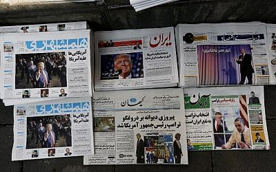 Local newspapers displaying articles on US president-elect Donald Trump a day after his election, Tehran, Iran, November 10, 2016. (AFP/ATTA KENARE)