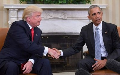US President Barack Obama and President-elect Donald Trump shake hands during a transition planning meeting in the Oval Office at the White House on November 10, 2016, in Washington,DC. (JIM WATSON/AFP)