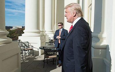 US President-elect Donald Trump walks onto a balcony at the US Capitol in Washington, DC, on November 10, 2016. (AFP/Nicholas Kamm)