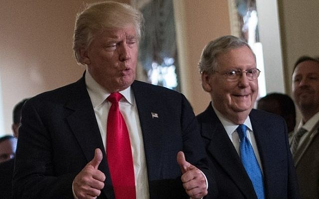 US President-elect Donald Trump gives the thumbs up after a meeting with Senate Majority Leader Mitch McConnell, right, at the Capitol in Washington, DC, on November 10, 2016. (AFP/Nicholas Kamm)