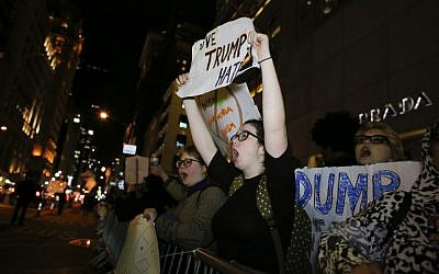 People take part in a protest against President-elect Donald Trump in front of Trump Tower in New York on November 10, 2016. (AFP/Kena Betancur)