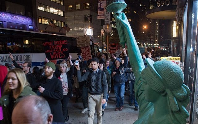 "Demonstrators march through Manhattan to Trump Tower  during a ""Love Rally"" march in New York on November 11, 2016, to protest the election of US President-elect Donald Trump. ( AFP PHOTO / Bryan R. Smith)"