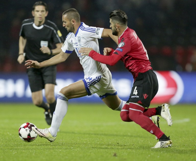Albania's Elseid Hysaj (R) vies with Israel's Ben Sahar during the 2018 World Cup group G qualifying football match between Albania and Israel, in Elbasan on November 12, 2016. (AFP PHOTO / GENT SHKULLAKU)