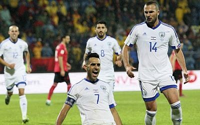 Israel's Eran Zahavi (center) celebrates after scoring a goal during the World Cup 2018 qualifier football match Albania versus Israel at the Elbasan Arena stadium in Elbasan on November 12, 2016.  (AFP PHOTO / GENT SHKULLAKU)