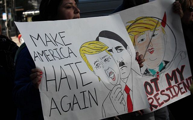 Demonstrators march in Chicago on November 12, 2016, to protest the election of US President-elect Donald Trump.(AFP PHOTO / Derek R. HENKLE)