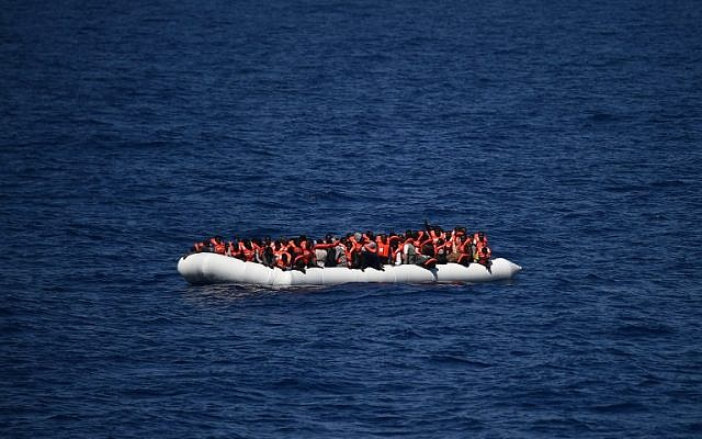 This file photo taken on May 24, 2016 shows African refugees waiting on a rubber boat to be rescued during an operation at sea, on May 24, 2016. (AFP/Gabriel Bouys)