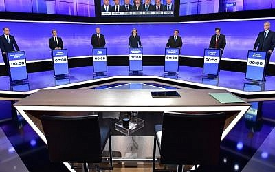 Candidates for France's right-wing party primaries prepare to take part in a televised debate on November 17, 2016. From left: Member of Parliament Jean-Francois Cope; former president Nicolas Sarkozy; former prime minister and Bordeaux mayor Alain Juppe; Member of Parliament Nathalie Kosciusko-Morizet; head of the French Christian Democratic Party Jean-Frederic Poisson; former prime minister and Member of the Parliament Francois Fillon; and former agriculture minister Bruno Le Maire. (AFP/Pool/Christophe Archambault)