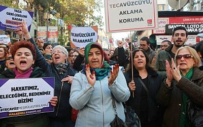 Turkish women stage a protest in Ankara on November 19, 2016 after a government legislation proposal that would overturn men's convictions for child sex assault if they married their victim. (AFP/Adem Altan)