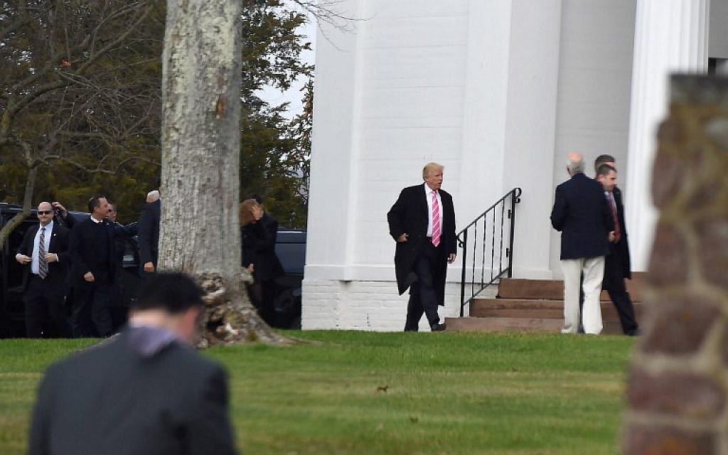 US President-elect Donald Trump arrives at the Lamington Presbyterian Church in Bedminster, New Jersey November 20, 2016 (AFP PHOTO / DON EMMERT)