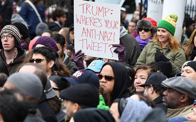 Activists protest racism and hate, after swastikas were found in Adam Yauch Park in Brooklyn, New York, on November 20, 2016.(AFP PHOTO / ANGELA WEISS)