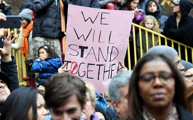 Activists protest racism and hate after swastikas were found in Adam Yauch Park in Brooklyn, New York on November 20, 2016. (AFP PHOTO / ANGELA WEISS)