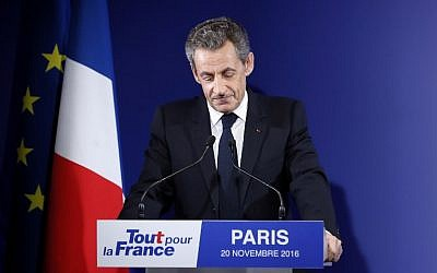 Former French President and candidate for the French right-wing presidential primary  Nicolas Sarkozy delivers a speech at his campaign headquarters after the vote's first round, on November 20, 2016 in Paris. (AFP PHOTO / POOL / IAN LANGSDON)