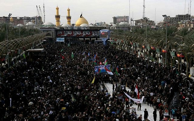Shiite Muslim pilgrims gather outside the Imam Hussein shrine on the last day of the Arbaeen religious festival on November 21, 2016, in the holy Iraqi city of Karbala, 50 miles (80 kilometers) south of Baghdad. (AFP/Mohammed SAWAF)