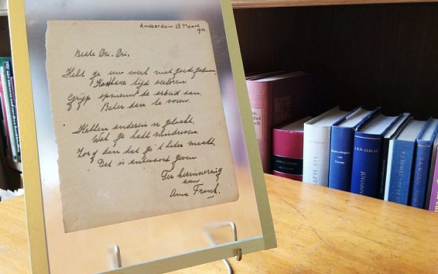 "This photo taken on November 21, 2016 at the Bubb Kuyper auction house in Haarlem shows a rare handwritten poem by Anne Frank, penned shortly before she went into hiding from the Nazis, addressed to ""Cri-Cri"" or Christiane van Maarsen, signed by the Jewish teenager and dated March 28, 1942. (AFP PHOTO/Maude BRULARD)"