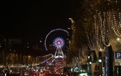 A photo taken on November 21, 2016 shows La Grande Roue ferris wheel in Paris after the Christmas lights of the Champs Elysees avenue were officially switched on during a ceremony. (AFP PHOTO / GEOFFROY VAN DER HASSELT)