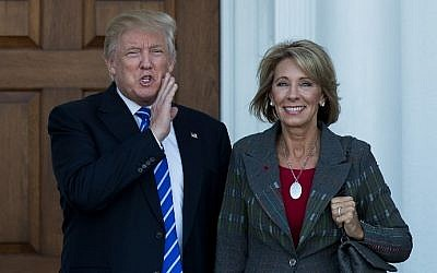 President-elect Donald Trump and Betsy DeVos after their November 18, 2016 meeting at Trump International Golf Club, in Bedminster Township, New Jersey.  (AFP PHOTO / GETTY IMAGES NORTH AMERICA / Drew Angerer)