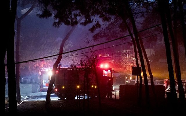 Israeli firefighters help extinguish a fire in the northern city of Haifa on November 24, 2016. (Jack Guez/AFP)
