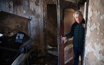 Haifa resident Aitan Shariel inspects the damage inside his house following a massive wildfire, on November 25, 2016. (AFP PHOTO/MENAHEM KAHANA)