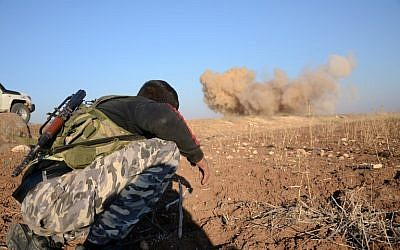 A rebel fighter reacts as a landmine, planted by Islamic State jihadists, is exploded by his comrades in the village of Tilalayn on the western outskirts of the northern Syrian town of Dabiq, on November 25, 2016. (AFP/ Nazeer al-Khatib)